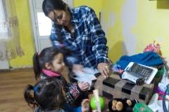 Lavinia and Florina Mares enjoying their shoebox